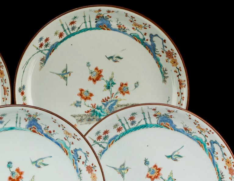 Five fine enameled porcelain either Kangxi or Quainlong plates with Japonese style Imari floral and birds motifs. They are from the Famille Vert and Famille rose schools with vibrant colors on milk white china.  Size: 9.2 inch, diameter (23.2