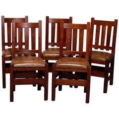 Five Antique Arts & Crafts Mission Oak and Leather Chairs attr Stickley Bros
