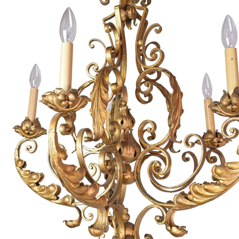 Ornate five-light painted iron chandelier featuring scroll and acanthus leaf detail. Elegant, opulent, and très chic!   Measures: 31