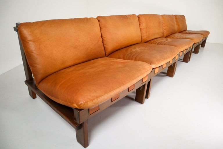 Pair of five lounge chairs by Carl Straub in absolutely gorgeous cognac leather and solid pinewood, circa 1960s. The the soft leather is beautifully patinated during use and age and. Altogether a lovely set that not only attracts attention by its