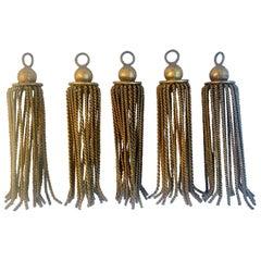 Five Gilt Metal Tassels