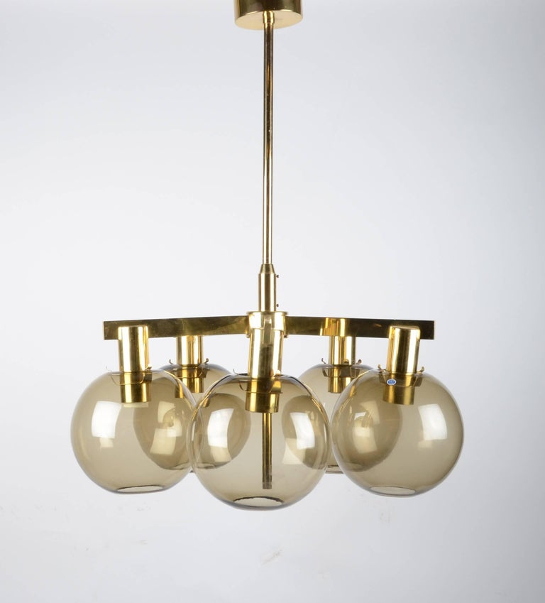 Chandelier in brass with five glass globes. Designed by Hans-Agne Jakobsson for Markaryd, Sweden, 1960s.