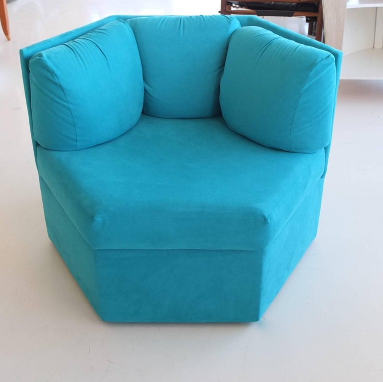 Pair of Milo Baughman for Thayer Coggin hexagonal swivel club chairs upholstered in turquoise ultra suede. Like brand new.  Attached triple back cushions and attached seat cushion.  Swivels 360 degrees.  Listed separately are three additional chairs
