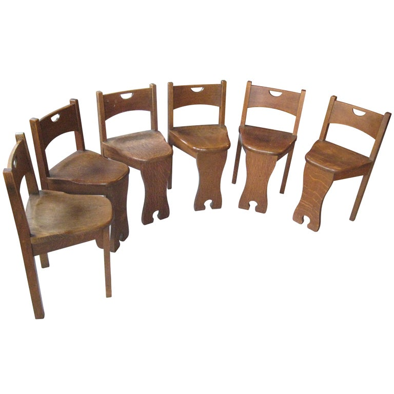 Made entirely of thick quarter-sawn oak, these little beauties are both sculptural and functional. Beautifully rounded seats; lovely cutouts on the backrest and front foot. The seat is dining chair height, but the backrest is very low.