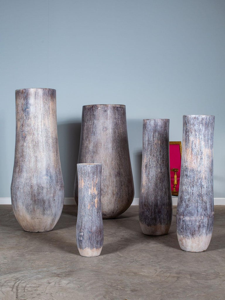 A set of five organic modern palmwood planter pots from Sumatra Indonesia hand rubbed with a grey washed finish. Natural sculptures enhanced by contemporary imagination. Please enlarge all the photographs to see the unique details in closeup. The