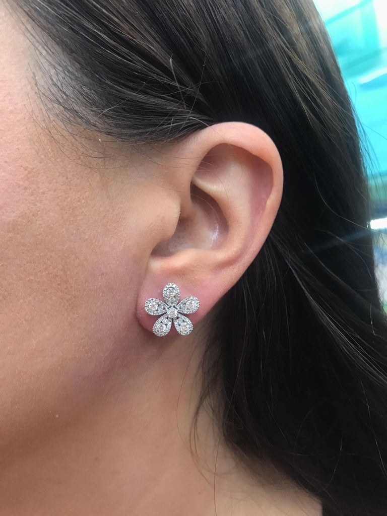 18K White gold flower earrings featuring 5 diamond petals of round brilliants weighing 1.36 carats.  Color G Clarity VS