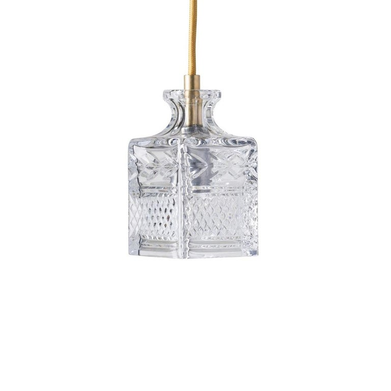 Gold linen cord accented mouth blown etched crystal canopy suspension lamps, composed in group set of 5.