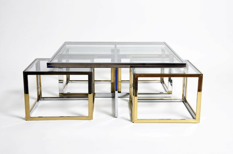 A rare Maison Jean Charles style low table made from chrome and glass coffee table ensemble in 5 parts. Manufactured and designed by Maison Jean Charles, France around 1970. Low Chrome table with 4 nesting cubes in brass and glass. Light scratches
