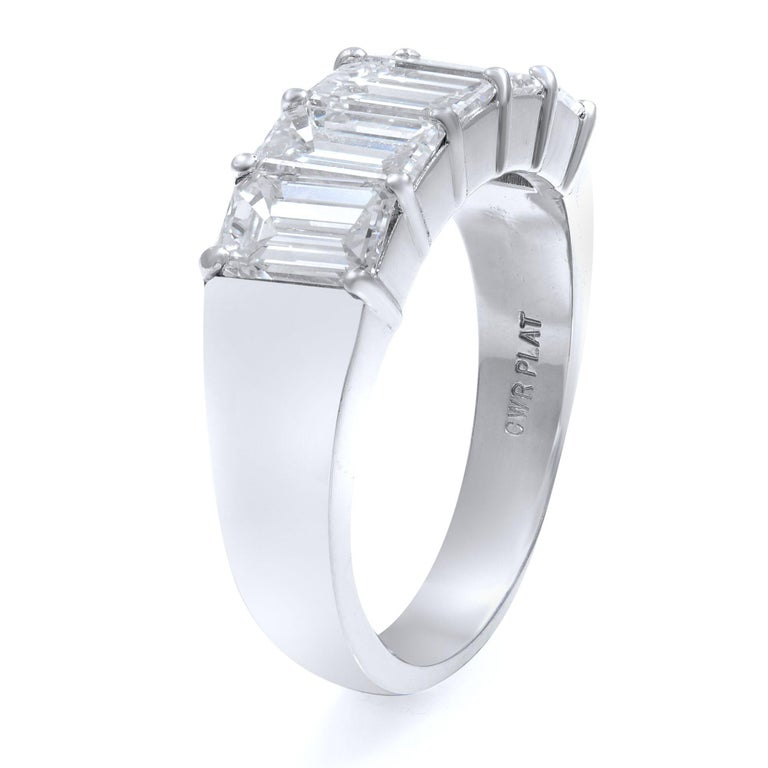 This classic ring features five beautifully matched emerald cut diamonds set in enduring platinum. Glistening with 2.57 carats of diamonds. Stone measurements are 6x8mm and weight of the whole piece is 5 grams. The clarity and color of the stones