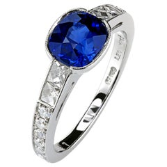 Five-Stone Platinum Ring with a Certified 1.69 Ct Blue Cushion Sapphire