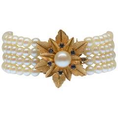 Five Strand Pearl Bracelet with 14 Karat Gold & Sapphire Floral Burst Clasp