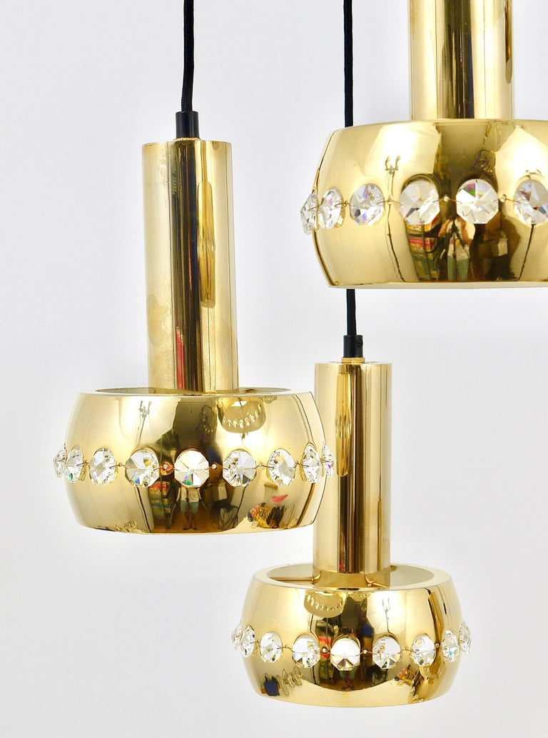 A beautiful brass five-arm cascading chandelier from the 1970s, designed an manufactured by Bakalowits & Söhne, Austria. Consisting of five lights, made of brass, the lampshades are covered with a row of diamond-shaped facetted crystals and hang on