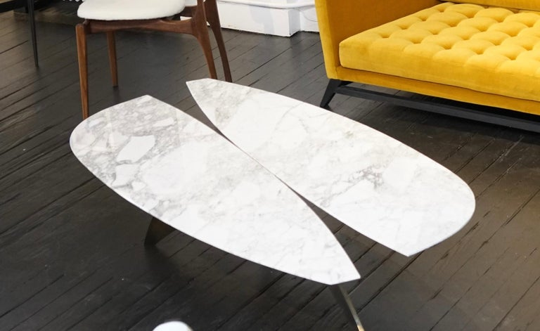 The Fjaril coffee table in marble and steel by Alexander Diaz Andersson has a steel base and a marble top available in white / black or custom marble.  The Fjail is named after the Swedish butterfly and takes its shape.  The aesthetic of this