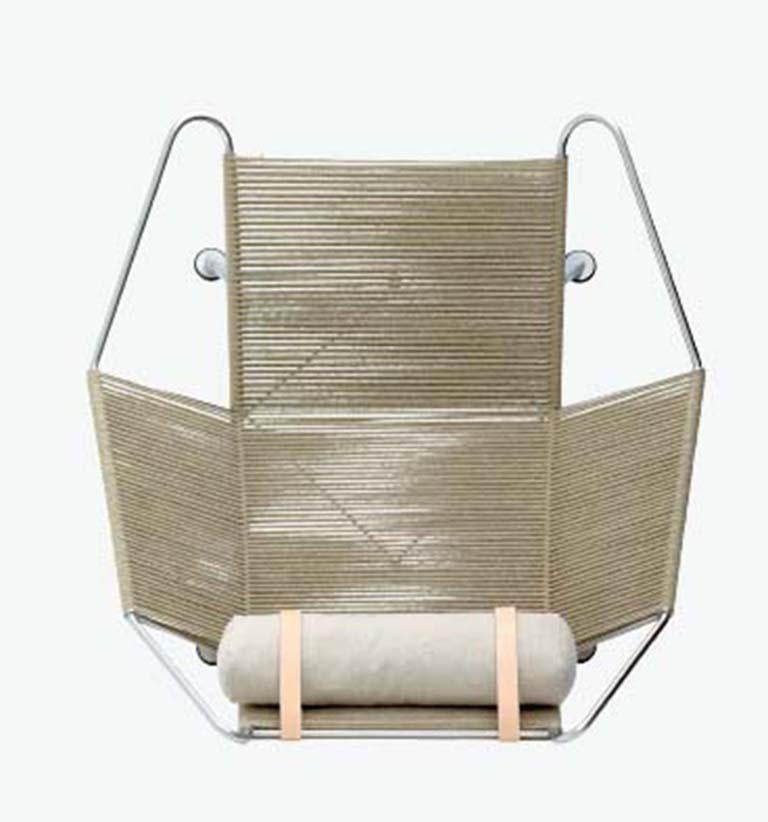 With a frame made of solid stainless steel, 240 metres specially developed flag line forming the seat and back, and a longhaired sheepskin softening the Industrial sharpness of the steel, this chair constitutes ultimate and luxurious relaxation.