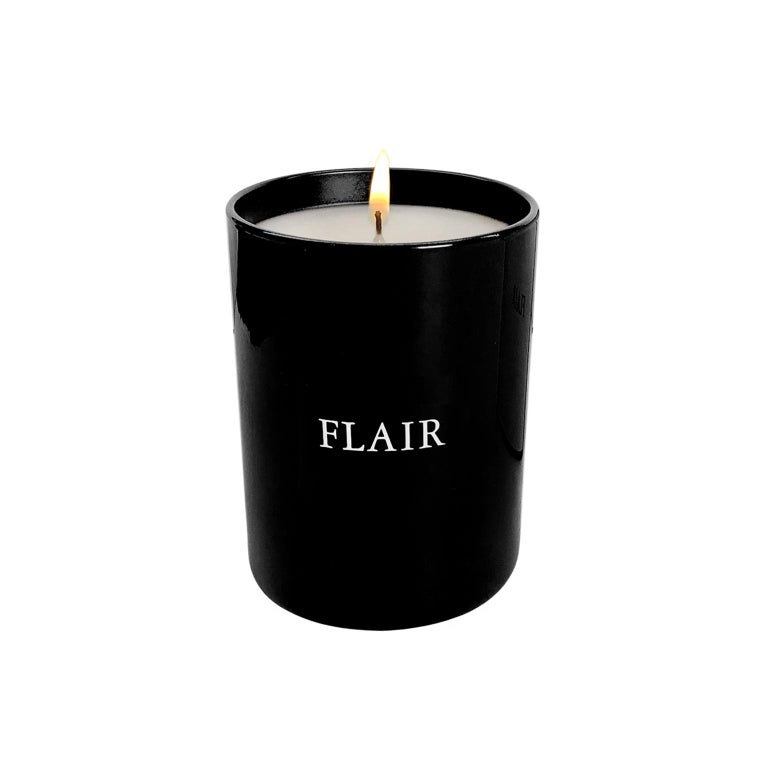 FLAIR Home collection candle in classic dark amber. Deep and mysterious, featuring a base scent of dark amber enhanced with notes of precious wood, tobacco, caramel and oak moss. Black glass 6.5 oz container. Made in France.
