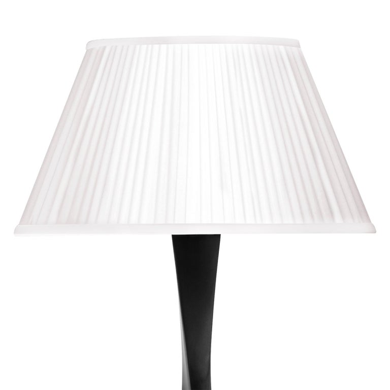 Table lamp flambeau with base in solid mahogany wood in black lacquered finish. With white pleated shade included. With 1 bulb, lamp holder type CE or UL standards, please specify. Also available in white lacquered or tobacco natural or gold