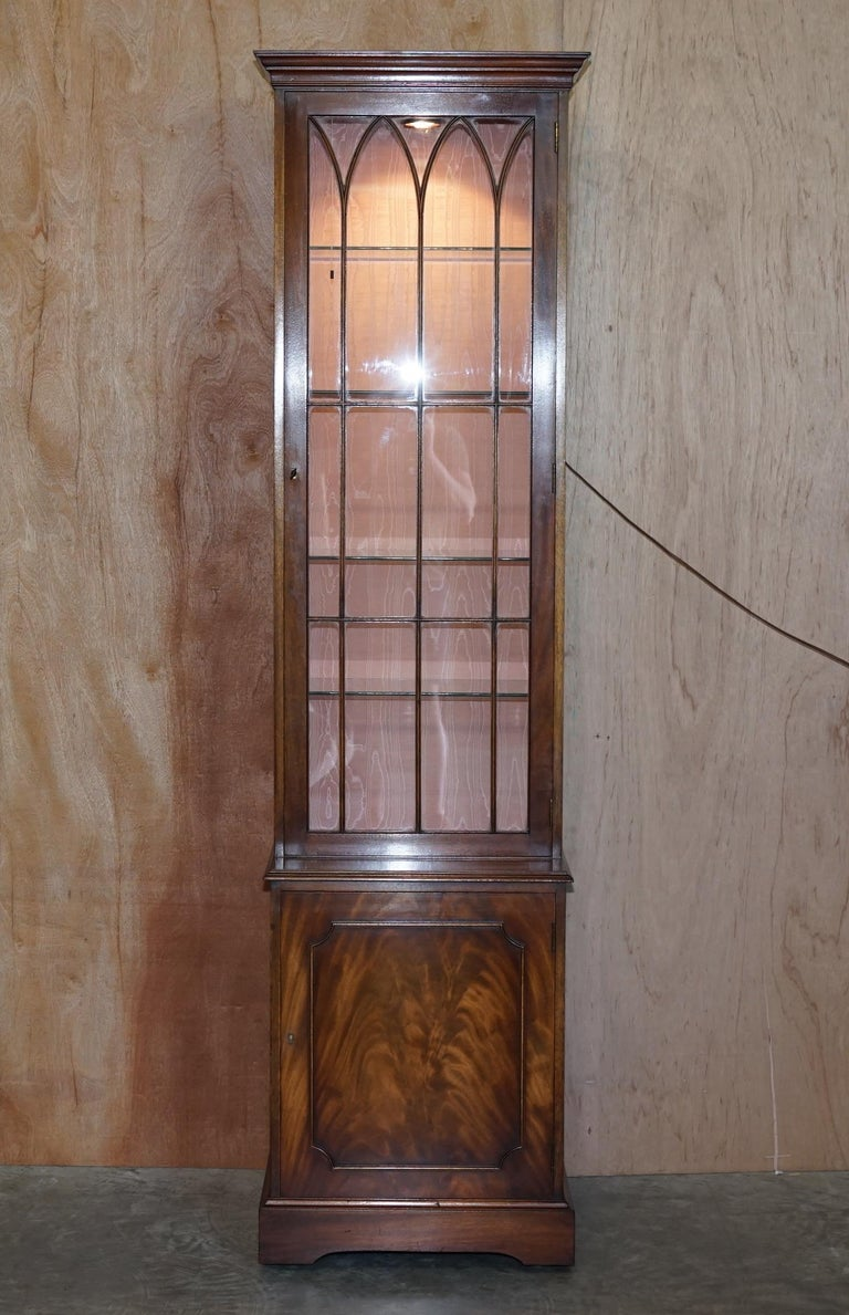We are delighted to offer for sale stunning vintage Bevan Funnell flamed mahogany with glass shelves and large spot light library bookcase or display cabinet  A very good looking and well made piece, the shelves are all hight adjustable and or