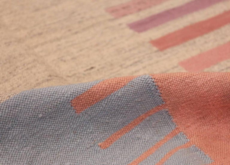 Breathtaking flat-woven Vintage Scandinavian Swedish Kilim rug, Country of Origin / rug Type: Scandinavia, circa Date: Mid–20th century. Size: 5 ft 7 in x 8 ft (1.7 m x 2.44 m)  This flat weave rug is such a happy mid century modern Scandinavian