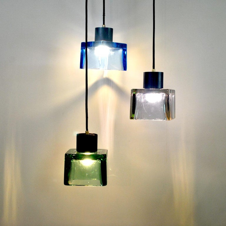 Chandelier by Flavio Poli for Seguso composed of three elements in Murano glass in three different colors with brass finishes.