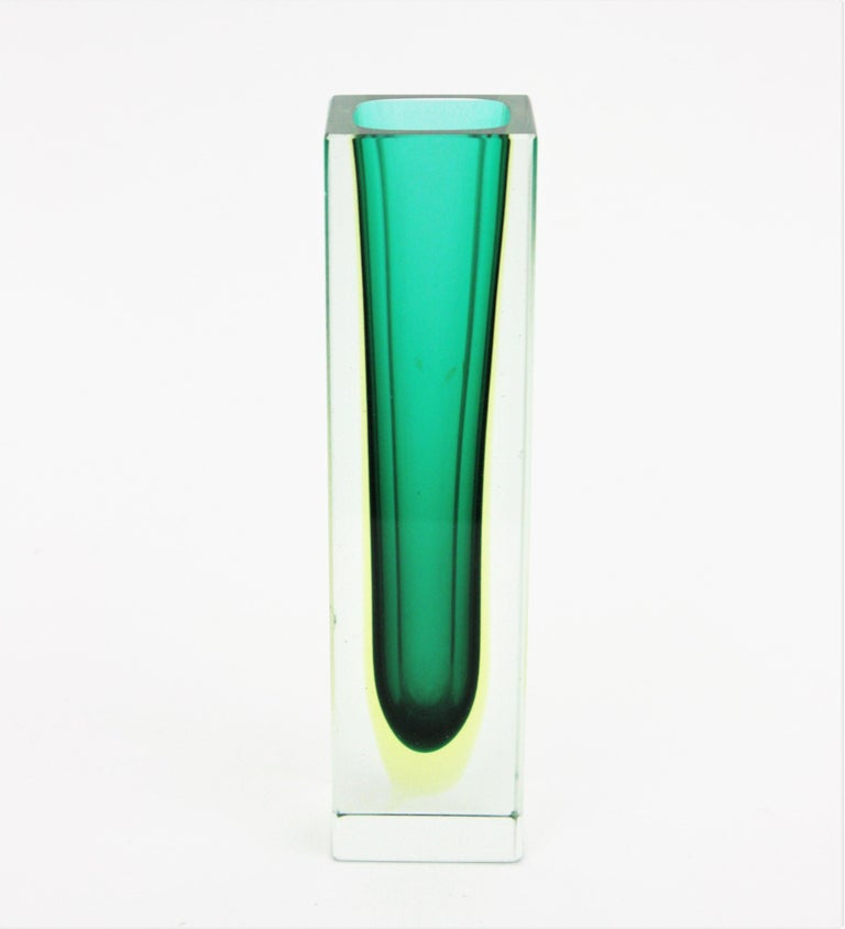 Eye-catching faceted sommerso green and yellow art glass vase. Attributed to Flavio Poli for Seguso. Italy, 1960s. Green glass with a layer in yellow glass submerged into clear glass using the Sommerso technique. Place it alone or as a part of a