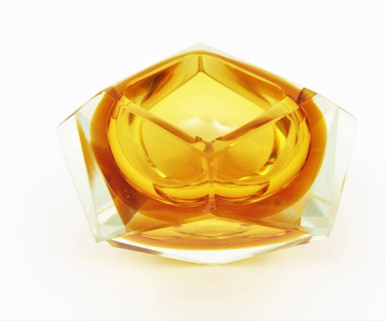 Eye-catching colorful yellow-orange giant sized Sommerso faceted Murano glass bowl attributed to Flavio Poli, Italy, 1950s.