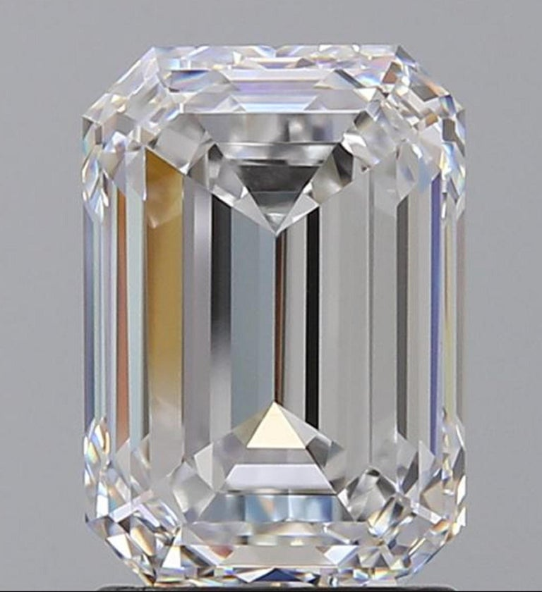 Modern Flawless Clarity GIA Certified 5.65 Carat Emerald Cut Diamond Platinum Ring For Sale