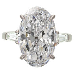 Flawless D Color GIA Certified 5.65 Carat Oval Diamond Tapered Baguette Ring