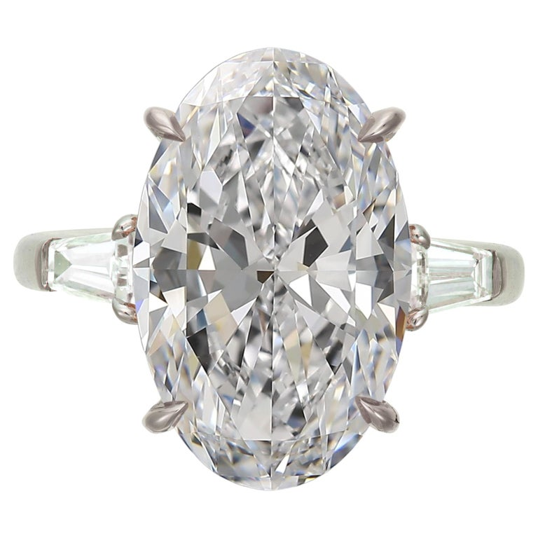 Flawless D Color GIA Certified 6.65 Carat Oval Diamond Tapered Baguette Ring For Sale