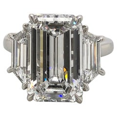 Flawless GIA Certified 4 Carat Emerald Cut Three Stone Engagement Ring