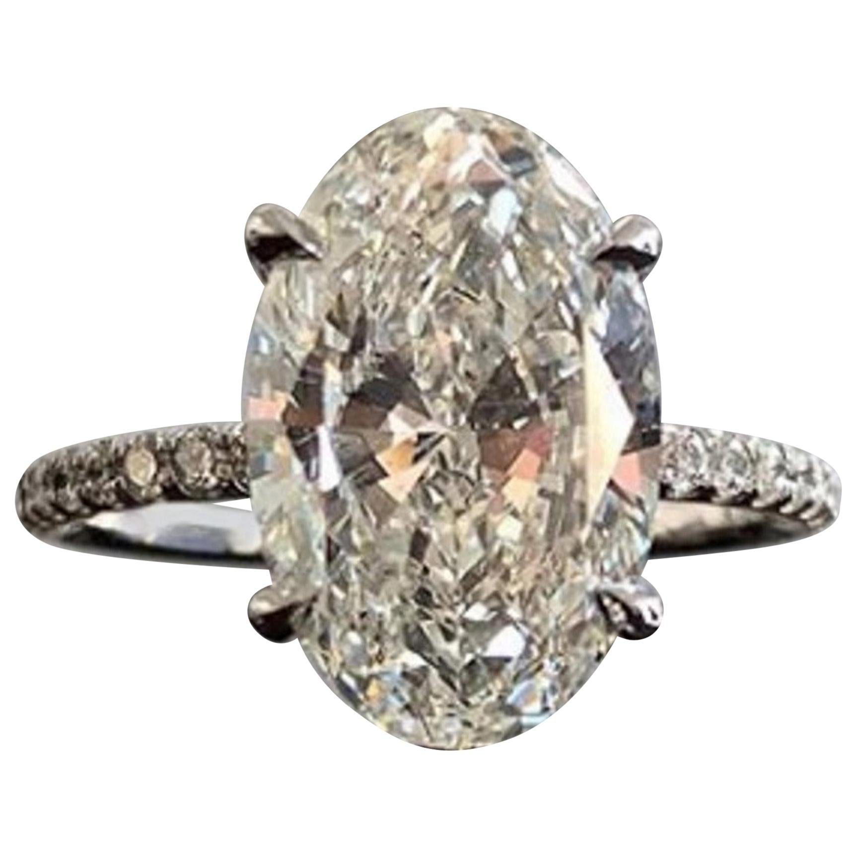 Flawless GIA Certified 7.31 Carat Oval Diamond Ring