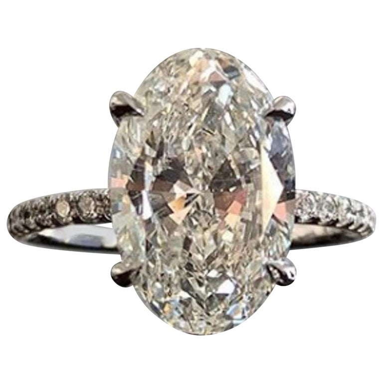 Flawless GIA Certified 7.31 Carat Oval Diamond Ring For Sale