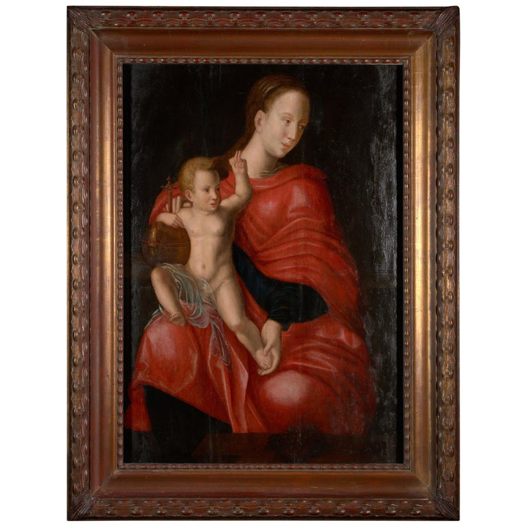 This lovely 17th century painting was made in the last part of the European Renaissance period, also known as the high renaissance, late 17th century. This scene depicts the Madonna with her Child. Mary is the center of the panel, wearing a scarlet