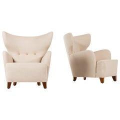 Flemming Lassen Attributed Pair of Wingback Easy Chairs Produced in Denmark