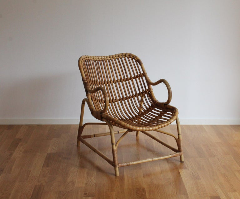 An early example of Flemming Lassen's iconic Bamboo chair model 340. This example is lightly restored, near the original condition. Produced by E. V. A. Nissen & Co., Denmark. Bears manufacturers metal plaque.  Other Danish designers of the era