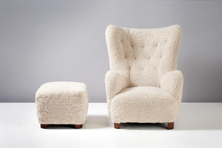 Flemming Lassen style Sheepskin lounge chair & Ottoman 1940s.  Large lounge chair & ottoman produced in Denmark in the 1940s in the manner of Flemming Lassen. Recently reupholstered in New Zealand sheepskin.