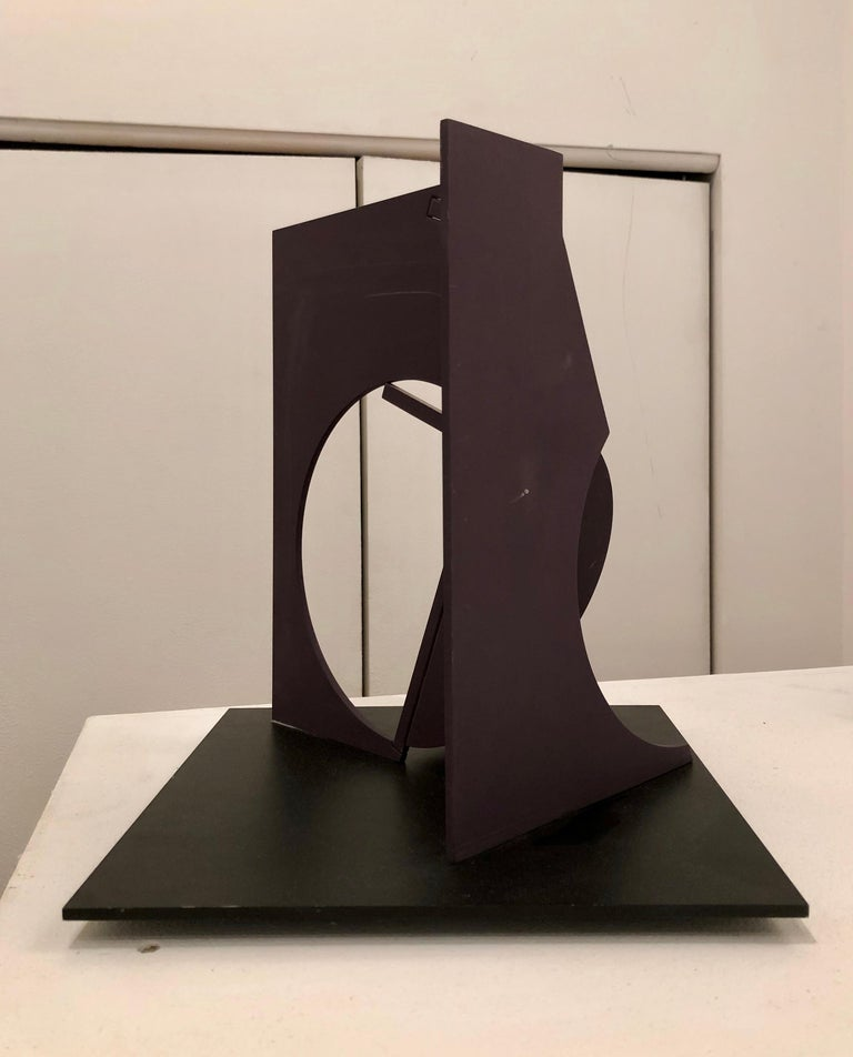 Benton, Folded Square Alphabet F (edition 3 of 3), 2006, black painted steel,  12x12x12in  Abstract sculpture in painted steel with geometric circular and square forms  Fletcher Benton is well-known for his geometric metal sculptures. His sculpture