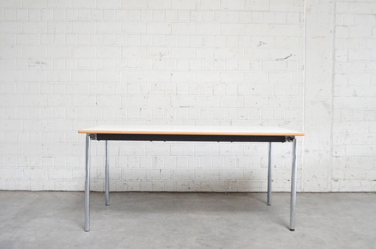 Danish table by Søren Nielsen & Thore Lassen for Randers and Radius. Danish office Classic piece. White formica surface. Side edge in beechwood. Chromed metal frame and steel tube. Folding table With a simple hand movement of the swivel mechanism