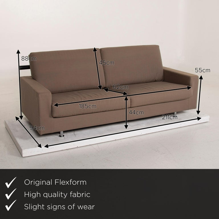 We present to you a Flexform fabric sofa beige two-seat.       Product measurements in centimeters:    Depth: 94 Width 211 Height 88 Seat height 44 Rest height 55 Seat depth 62 Seat width 185 Back height 45.