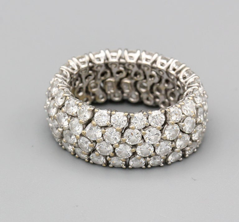 Fine diamond and 18k white gold band of flexible design.  Features approx. 6.0-6.5 carats of round brilliant cut diamonds of high color and clarity (g-H, VS1-2).  The