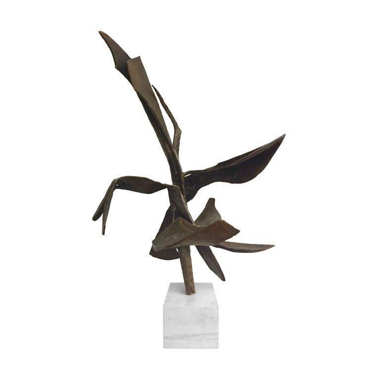Bronze abstract sculpture on white marble base, entitled