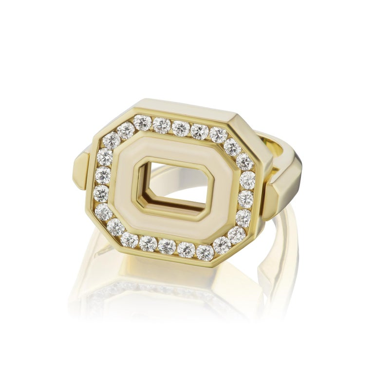 Our Museum Series Flip Ring in 18K yellow gold that is two sided for more versatility. An East/West set Octagon framed in gold with a line of cream enamel and .55 carats of GH VSI diamonds on one side. On the other side is a row of black enamel with