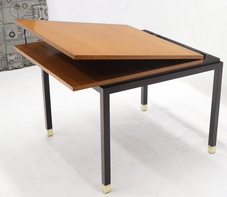 Mid-Century Modern double size two tone finish expandable game to dining or conference table. Standing on nice ebonized finish base / legs with solid brass tips. Expands up to 68