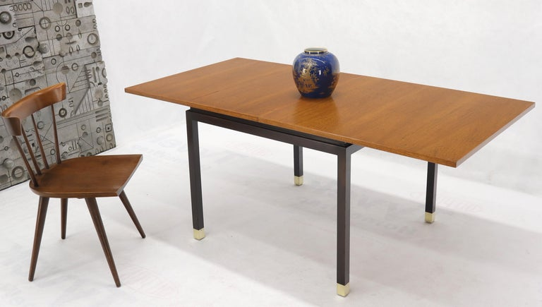 Mid-Century Modern Flip Top Expandable Square Game Table on Parsons Ebonized legs with Brass Tips For Sale