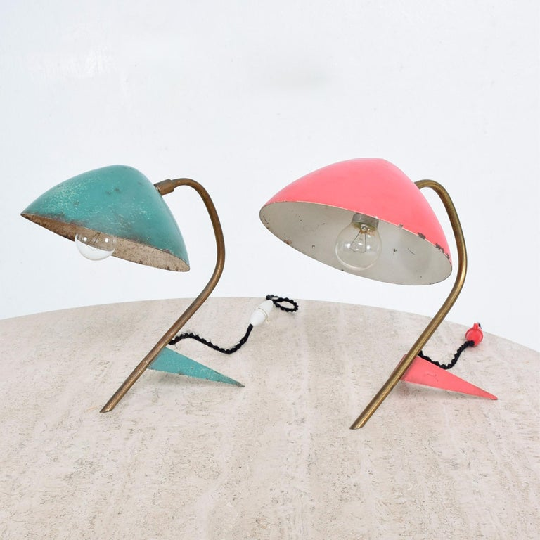 Sculptural pair of French Mid-Century Modern table lamps attributed to Jean Boris Lacroix 1950s  Similar in style to French designers Pierre Guariche and Jacques Biny  One lamp is green one is red. Painted aluminum patinated brass and