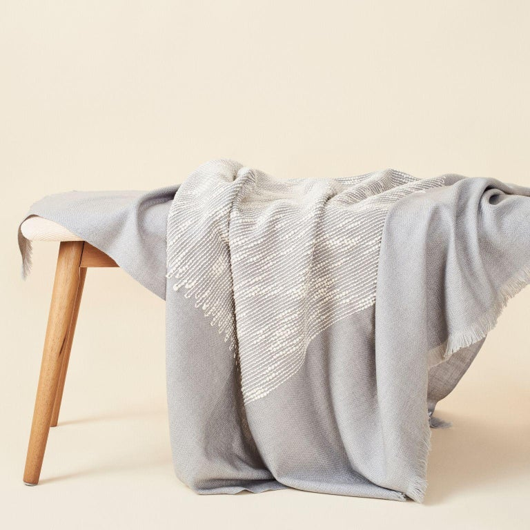 Custom design by Studio Variously, FLO grey throw / blanket is a beautifully handwoven and carefully hand embroidered piece by master weavers in Nepal , and dyed entirely with earth-friendly certified Swiss dyes. A sustainable design brand based out