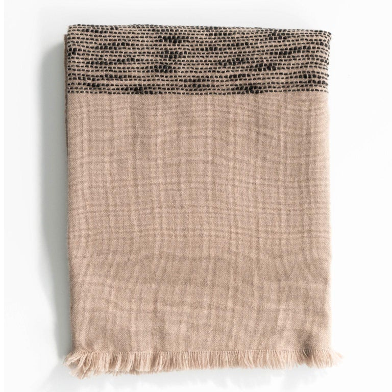Custom design by Studio Variously, FLO Merino Throw / Blanket is a large square textile handwoven by master weavers in Nepal and dyed entirely with earth-friendly dyes.   A sustainable design brand based out of Michigan, Studio Variously exclusively