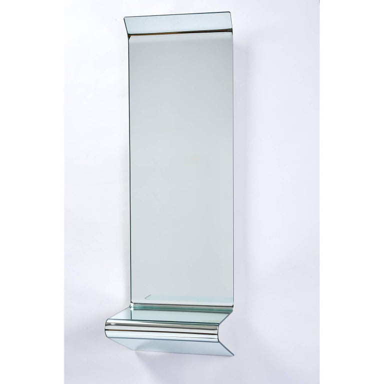 Fiam Italia, 2005. Floating mirrored console by FIAM formed of a single sheet of folded mirrored glass, with angled top edge and integral shelf. Makers mark and date Measures: 44 H x 14.25 W x 11.5 D.