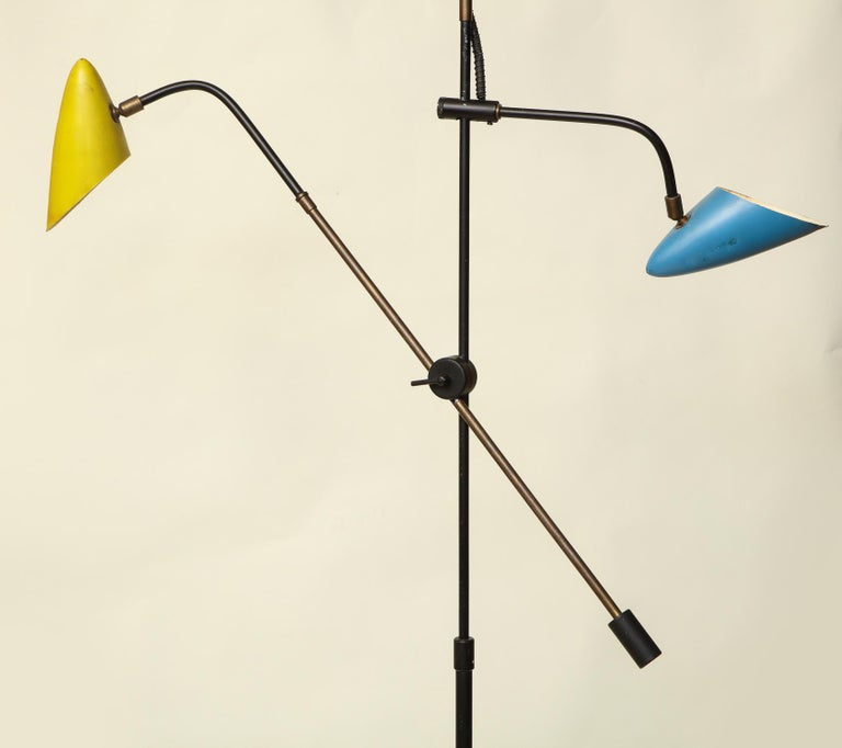 An articulated floor lamp sculptural Mid-Century Modern shades and arms adjust France early 1950s.