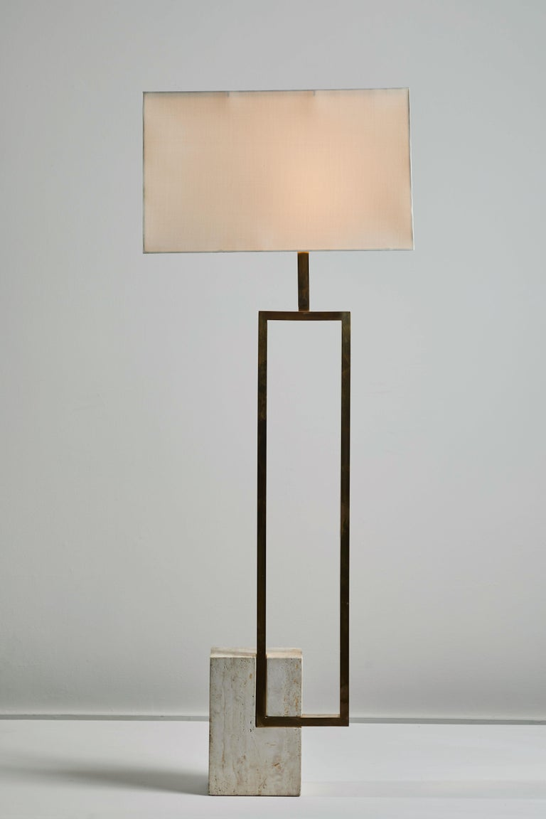 Floor lamp by Giovanni Banci for Banci Firenze. Designed and manufactured in Italy, circa 1970s. Travertine base and brass plated hardware with custom silk shade. Rewired for US sockets. On or off step switch. Takes one E27 75w maximum bulb.