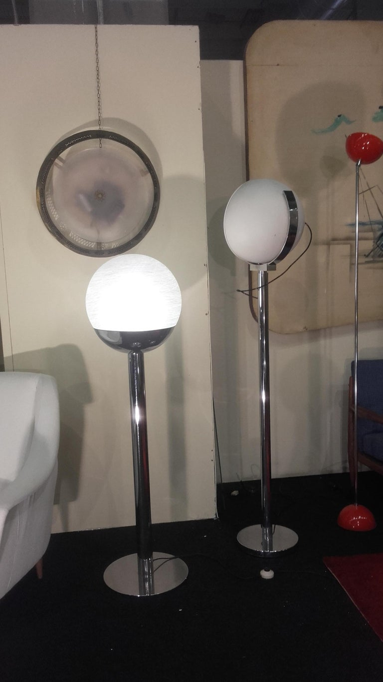 Floor lamp produced by Lumi in 1968, with a plated steel and opaque  Murano glass globe.
